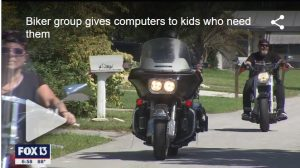 Bikers group give computers to kids who need them